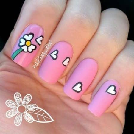 diseño de uñas rosa con flores 1