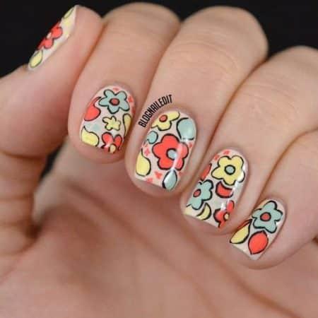 diseños de uñas con flores rojas