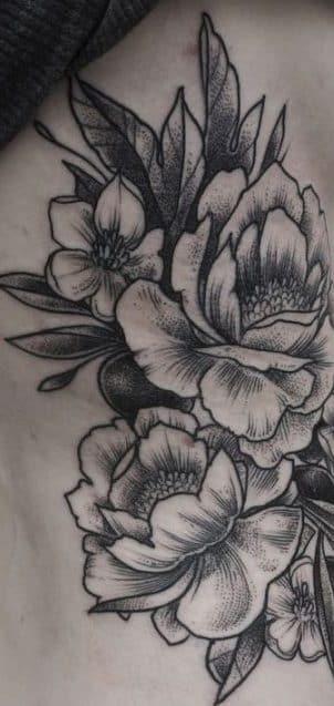 tatuajes costillas flores e1507557161630